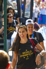 United States women's soccer team member Alex Morgan, foreground, sticks out her tongue as teammate Crystal Dunn follows her Monday, July 8, 2019, in New York. The city will honor the team with a parade Wednesday for their fourth Women's World Cup victory. (AP Photo/Corey Sipkin)