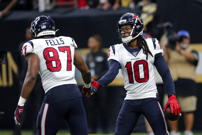 Houston Texans wide receiver DeAndre Hopkins (10) celebrates his touchdown reception with Houston Texans tight end Darren Fells (87) in the second half of an NFL football game against the New Orleans Saints in New Orleans, Monday, Sept. 9, 2019. (AP Photo/Bill Feig)