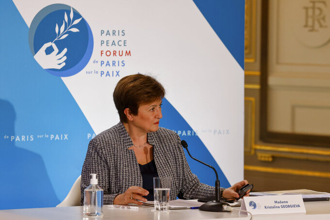 FILE - In this Nov. 12, 2020 file photo, International Monetary Fund Managing Director Kristalina Georgieva attends the Paris Peace Forum at The Elysee Palace in Paris.   Georgieva said Tuesday, March 30, 2021, that when the IMF releases its updated economic forecast next week, it will show the global economy growing at a faster pace than the 5.5% gain it projected at the start of the year.  (Ludovic Marin, Pool via AP)