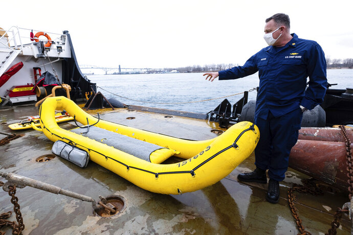 U.S. Coast Guard's William Hosford talks about an inflatable craft used for ice rescues Wednesday, Jan. 6, 2021, on the buoy deck of the USCG Cutter Hollyhock in Port Huron, Mich. The raft has three air chambers and can be inflated within a matter of seconds. (Brian Wells/The Times Herald via AP)