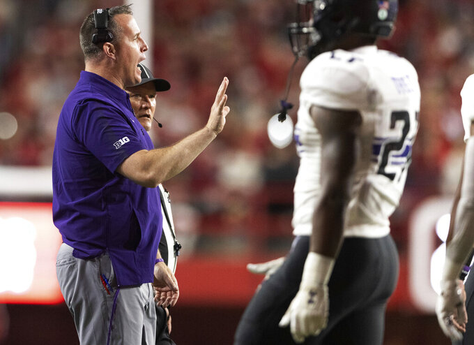 Northwestern head coach Pat Fitzgerald speaks to his players during a timeout against Nebraska during the second half of an NCAA college football game, Saturday, Oct. 2, 2021, at Memorial Stadium in Lincoln, Neb. (AP Photo/Rebecca S. Gratz)