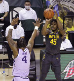 Baylor guard Davion Mitchell (45) shoots a three point shot over Kansas State forward Seryee Lewis (4) in the first half of an NCAA college basketball game, Wednesday, Jan. 27, 2021, in Waco, Texas. (AP Photo/Jerry Larson)
