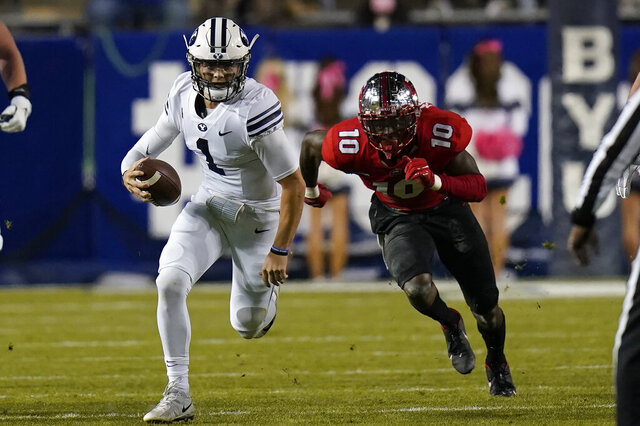 BYU quarterback Zach Wilson (1) out runs Western Kentucky defensive end DeAngelo Malone (10) during the first half of an NCAA college football game Saturday, Oct. 31, 2020, in Provo, Utah. (AP Photo/Rick Bowmer, Pool)