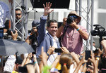 Venezuela's self-proclaimed interim president Juan Guiado greets the crowd during an event to swear in nurses, doctors, professionals and others, as the group that will help with the arrival and distribution of humanitarian aid in Venezuela, in Caracas, Venezuela, Saturday, Feb. 16, 2019. The U.S. Air Force has begun flying tons of aid to a Colombian town on the Venezuelan border as part of an effort meant to undermine socialist President Nicolas Maduro. The first of three C-17 cargo planes has flown from Homestead Air Reserve Base in Florida and landed in the town of Cucuta. (AP Photo/Ariana Cubillos)