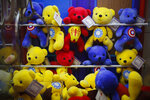 Chinese-made teddy bears carrying American hit movie Avengers characters are displayed inside an arcade game at a shopping mall in Beijing, Wednesday, July 11, 2018. China's government has criticized the latest U.S. threat of a tariff hike as