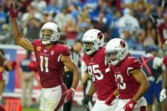 Arizona Cardinals wide receiver Larry Fitzgerald (11), tight end Charles Clay (85) and wide receiver Christian Kirk (13) celebrate Kirk's two point conversion against the Detroit Lions during the second half of an NFL football game, Sunday, Sept. 8, 2019, in Glendale, Ariz. (AP Photo/Rick Scuteri)