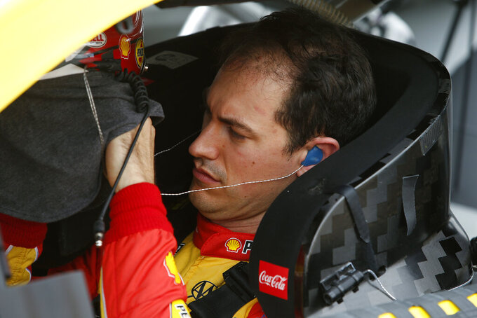 Joey Logano in his race car prior to the NASCAR Cup Series auto race at Phoenix Raceway, Sunday, Nov. 8, 2020, in Avondale, Ariz. (AP Photo/Ralph Freso)