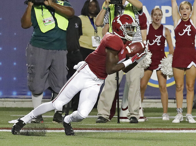 Alabama wide receiver Jerry Jeudy catches an 11-yard pass for a touchdown against Louisville during the first half of an NCAA college football game Saturday, Sept. 1, 2018, in Orlando, Fla. (AP Photo/John Raoux)