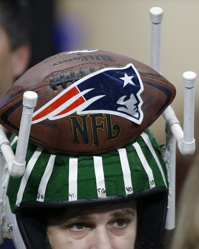 A New England Patriots fan walks inside the stadium with a home made hat, before the NFL Super Bowl 53 football game between the Los Angeles Rams and the New England Patriots Sunday, Feb. 3, 2019, in Atlanta. (AP Photo/Mark Humphrey)