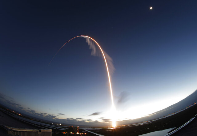 In this long exposure photo, the United Launch Alliance Atlas V rocket carrying the Boeing Starliner crew capsule lifts off on an orbital flight test to the International Space Station from Space Launch Complex 41 at Cape Canaveral Air Force station, Friday, Dec. 20, 2019, in Cape Canaveral, Fla. Boeing's new capsule ended up in the wrong orbit after lifting off on its first test flight Friday, a blow to the company's effort to launch astronauts for NASA next year. (AP Photo/Terry Renna)
