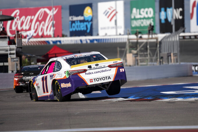 Denny Hamlin (11) drives during a NASCAR Cup Series auto racing race at Charlotte Motor Speedway, Sunday, Oct. 10, 2021, in Concord, N.C. (AP Photo/Matt Kelley)
