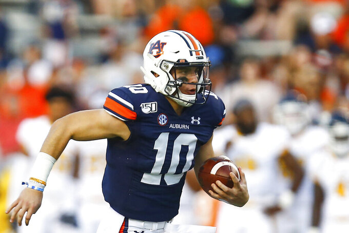FILE - In this Sept. 14, 2019, file photo, Auburn quarterback Bo Nix (10) carries the ball during the first half of an NCAA college football game against Kent State, in Auburn, Ala. With a collective seven career starts between them, No. 7 Auburn's quarterback Bo Nix and No. 10 Florida's Kyle Trask are set to face off in a Top 10 showdown. (AP Photo/Butch Dill, File)