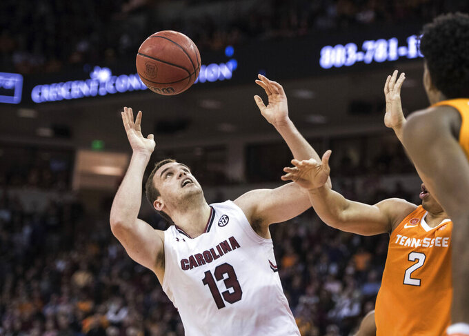 South Carolina forward Felipe Haase (13) battles for a rebound against Tennessee forward Grant Williams (2) during the second half of an NCAA college basketball game Tuesday, Jan. 29, 2019, in Columbia, S.C. Tennessee defeated South Carolina 92-70. (AP Photo/Sean Rayford)