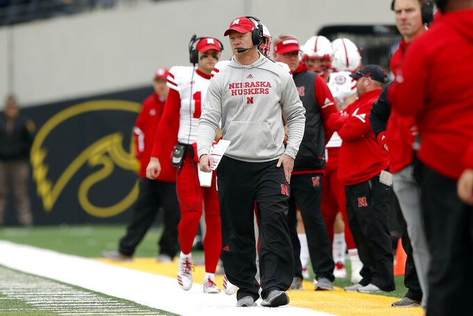 Nebraska head coach Scott Frost watches from the sideline during the second half of an NCAA college football game against Iowa, Friday, Nov. 23, 2018, in Iowa City, Iowa. Iowa won 31-28. (AP Photo/Charlie Neibergall)