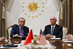 FILE - In this Thursday, Oct. 17, 2019 file photo, Vice President Mike Pence meets with Turkish President Recep Tayyip Erdogan at the Presidential Palace for talks on the Kurds and Syria, in Ankara, Turkey. The Turkish assault on northern Syria in the wake of President Donald Trump's troop withdrawal from the region has jeopardized a goal often spotlighted by Trump: global freedom to worship for religious minorities. Top Trump advisers said a Thursday ceasefire would help minority faiths, but it's not yet clear that the pact will give them the durable protection Kurdish control had offered.  (AP Photo/Jacquelyn Martin, File)