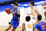 Florida's Tre Mann (1) drives against Tennessee's John Fulkerson (10) in the first half of an NCAA college basketball game in the Southeastern Conference Tournament Friday, March 12, 2021, in Nashville, Tenn. (AP Photo/Mark Humphrey)