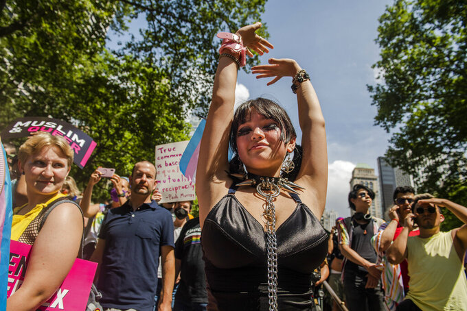 Ione Shih poses for a portrait at Bryant Park for the Queer Liberation March on Sunday, June 27, 2021, in New York. (AP Photo/Brittainy Newman)