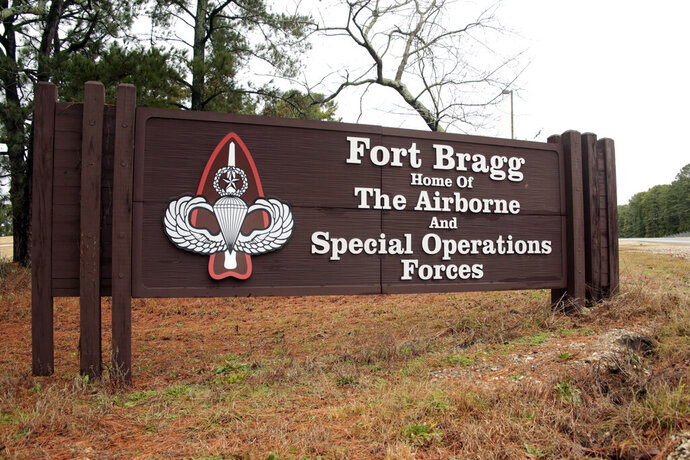 FILE - In this Jan. 4, 2020, file photo a sign for at Fort Bragg, N.C., is shown. A female soldier has graduated from the Army's elite Special Forces course and will for the first time join one of the all-male Green Beret teams. (AP Photo/Chris Seward, File)