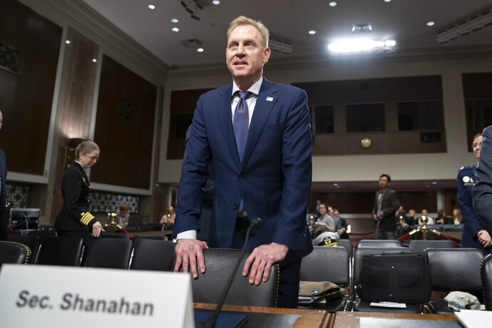 "In this March 14, 2019, photo, acting Defense Secretary Patrick Shanahan goes before the Senate Armed Services Committee to discuss the Department of Defense budget, on Capitol Hill in Washington. To a remarkable degree, the Pentagon's new budget proposal is shaped by national security threats that Shanahan has summarized in three words: ""China, China, China."" (AP Photo/J. Scott Applewhite)"