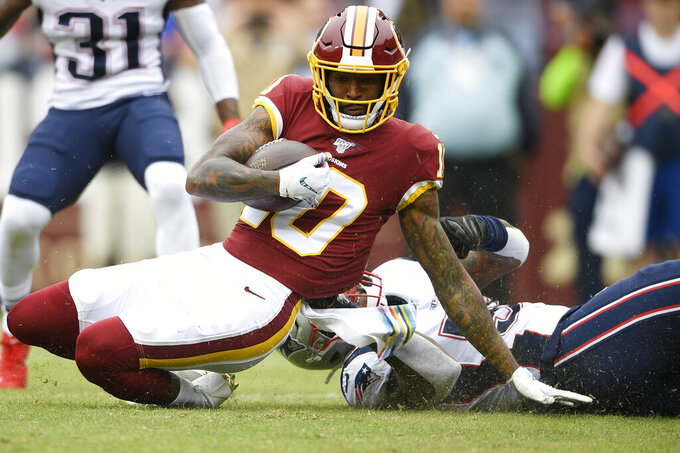 New England Patriots outside linebacker Jamie Collins (58) tackles Washington Redskins wide receiver Paul Richardson (10) during the first half of an NFL football game, Sunday, Oct. 6, 2019, in Washington. (AP Photo/Nick Wass)
