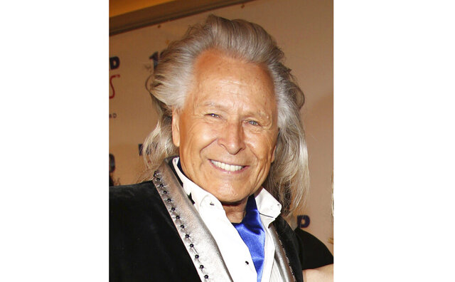 FILE - Peter Nygard attends the 24th Night of 100 Stars Oscars Viewing Gala on March 2, 2014, in Beverly Hills, Calif. Nygard faces criminal charges in New York after his Canadian arrest on charges alleging that he dangled opportunities in fashion and modeling to lure dozens of women and girls to have sex with himself and others. The 79-year-old Nygard awaited an appearance in a Winnipeg courtroom after his Monday, Dec. 14, 2020, arrest in Winnipeg, Manitoba, Canada by Canadian authorities at the request of the United States. (Photo by Annie I. Bang /Invision/AP, File)
