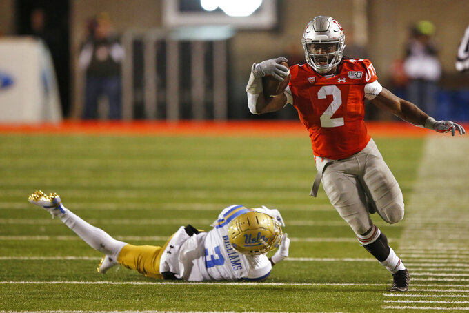 Utah running back Zack Moss (2) out runs UCLA defensive back Rayshad Williams (3) during the first half during an NCAA college football game Saturday, Nov. 16, 2019, in Salt Lake City. (AP Photo/Rick Bowmer)