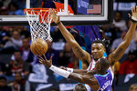 Charlotte Hornets guard Terry Rozier, front, shoots against Chicago Bulls center Wendell Carter Jr. during the first half of an NBA basketball game in Charlotte, N.C., Wednesday, Oct. 23, 2019. (AP Photo/Nell Redmond)