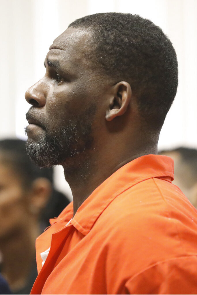 R. Kelly appears during a hearing at the Leighton Criminal Courthouse on Tuesday, Sept. 17, 2019 in Chicago. A judge in R. Kelly's Illinois sexual assault case has refused to give $100,000 in bail money back to a Kelly friend who paid it in February to secure the singer's release from county jail.  (Antonio Perez/ via AP Pool)