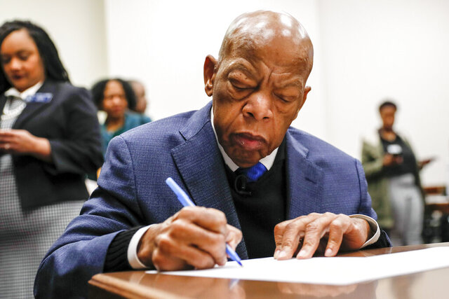 Congressman John Lewis signs paperwork to qualify for reelection to his District 5 seat in Atlanta, Monday, March 2, 2020. Georgia's political season kicks into high gear Monday as qualifying for state and federal offices begins. (Bob Andres/Atlanta Journal-Constitution via AP)