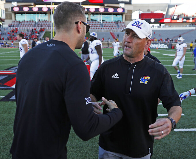 Texas Tech coach Kliff Kingsbury shakes hands with Kansas coach David Beaty after an NCAA college football game Saturday, Oct. 20, 2018, in Lubbock, Texas. (Brad Tollefson/Lubbock Avalanche-Journal via AP)/Lubbock Avalanche-Journal via AP)