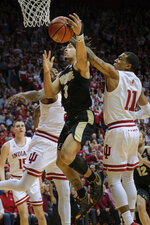 Purdue guard Carsen Edwards (3) tries to shoot as Indiana guard Devonte Green (11) defends during the first half of an NCAA college basketball game in Bloomington, Ind., Tuesday, Feb. 19, 2019. (AP Photo/AJ Mast)