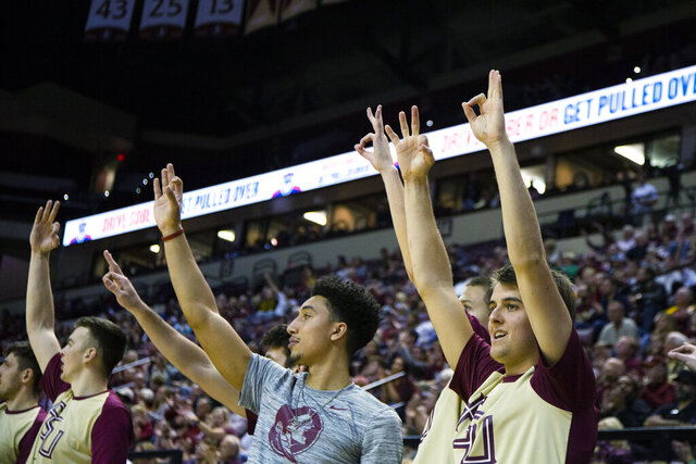 Florida State Nathaniel Jack, center, and teammates flash the 3s late in the second half of an NCAA college basketball game against Clemson in Tallahassee, Fla., Sunday, Dec. 8, 2019. Florida State defeated Clemson 72-53. (AP Photo/Mark Wallheiser)