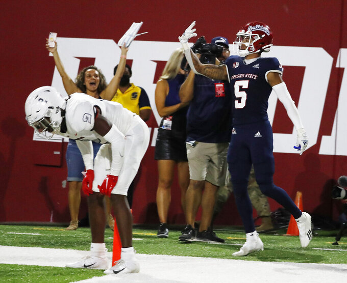 Fresno State wide receiver Jalen Cropper, right, celebrates a game winning touchdown against UNLV as defensive back Nohl Williams looks on during the second half of an NCAA college football game in Fresno, Calif., Friday, Sept. 24, 2021. (AP Photo/Gary Kazanjian)