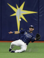 Tampa Bay Rays center fielder Kevin Kiermaier makes a sliding catch on a flyout by Boston Red Sox's Mookie Betts during the sixth inning of a baseball game Monday, Sept. 23, 2019, in St. Petersburg, Fla. (AP Photo/Chris O'Meara)