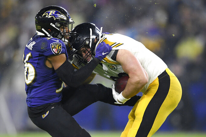 Baltimore Ravens defensive back Chuck Clark, left, brings down Pittsburgh Steelers tight end Vance McDonald during the first half of an NFL football game, Sunday, Dec. 29, 2019, in Baltimore. (AP Photo/Nick Wass)