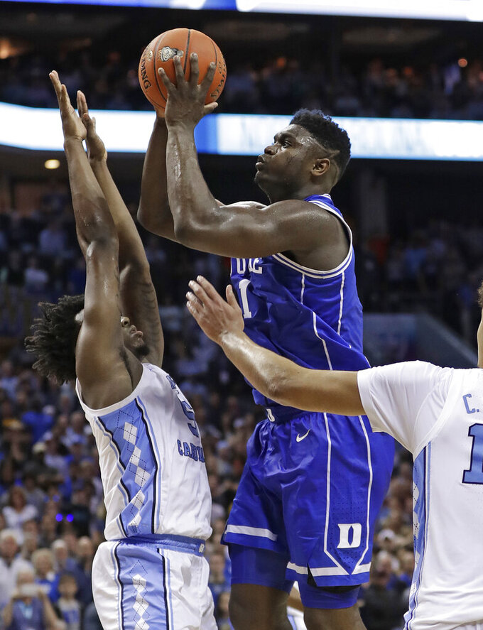 Duke's Zion Williamson (1) shoots against North Carolina's Nassir Little (5) in the final seconds of the second half of an NCAA college basketball game in the Atlantic Coast Conference tournament in Charlotte, N.C., Friday, March 15, 2019. (AP Photo/Nell Redmond)