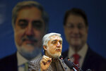 Afghan presidential candidate Abdullah Abdullah speaks during a press conference in Kabul, Afghanistan, Sunday, Nov. 17, 2019. The Afghan election commission has tried to launch another ballot recount but presidential candidate Abdullah Abdullah halted the attempt by saying he won't let his observers participate. (AP Photo/Rahmat Gul)