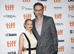 Actor Stephen Merchant, right, and girlfriend Mircea Monroe attend the premiere for