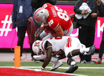 Ohio State tight end Luke Farrell, (89) scores a touchdown past Rutgers defensive back Avery Young during the first half of an NCAA college football game Saturday, Sept. 8, 2018, in Columbus, Ohio. (AP Photo/Jay LaPrete)