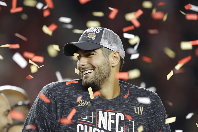 San Francisco 49ers quarterback Jimmy Garoppolo celebrates after the NFL NFC Championship football game against the Green Bay Packers Sunday, Jan. 19, 2020, in Santa Clara, Calif. The 49ers won 37-20 to advance to Super Bowl 54 against the Kansas City Chiefs. (AP Photo/Ben Margot)