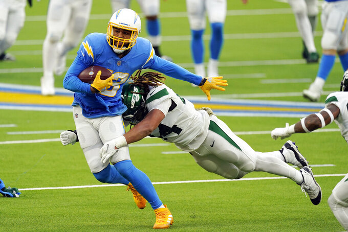 Los Angeles Chargers wide receiver Keenan Allen, left, is tackled by New York Jets linebacker Harvey Langi during the second half of an NFL football game Sunday, Nov. 22, 2020, in Inglewood, Calif. (AP Photo/Jae C. Hong )