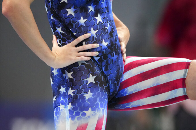 Allison Schmitt, of the United States, stretches ahead of swimming in a heat of the women's 200-meter freestyle at the 2020 Summer Olympics, Monday, July 26, 2021, in Tokyo, Japan. (AP Photo/Matthias Schrader)
