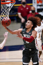 Washington State guard Isaac Bonton (10) drives with the ball against California during the second half of an NCAA college basketball game, Thursday, Jan. 7, 2021, in Berkeley, Calif. (AP Photo/Tony Avelar)
