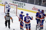 New York Islanders' Josh Bailey, right, celebrates with teammates as Tampa Bay Lightning goaltender Andrei Vasilevskiy (88) skates away after Bailey scored a goal during the third period of an NHL hockey game Friday, Nov. 1, 2019, in Uniondale, N.Y. The Islanders won 5-2. (AP Photo/Frank Franklin II)