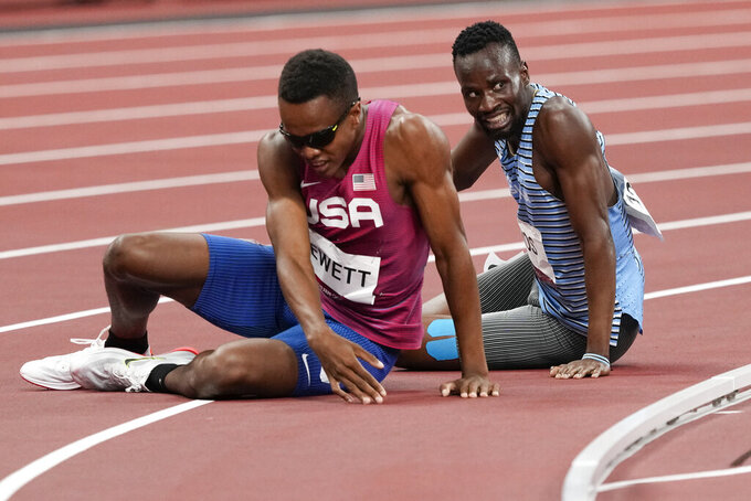 Isaiah Jewett, of the United States, and Nijel Amos, right, of Botswana, fall in the men's 800-meter semifinal at the 2020 Summer Olympics, Sunday, Aug. 1, 2021, in Tokyo. (AP Photo/Jae C. Hong)