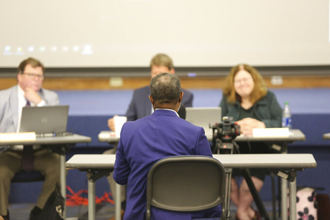A citizen testifies at a public meeting of a Senate subcommittee on redistricting on Wednesday, July 28, 2021, in Sumter, S..C. Senators are holding 10 public hearings across the state. (AP Photo/Jeffrey Collins)