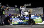 Kyle Larson celebrates in Victory Lane after winning the NASCAR All-Star Race at Charlotte Motor Speedway in Concord, N.C., Saturday, May 18, 2019. (AP Photo/Chuck Burton)