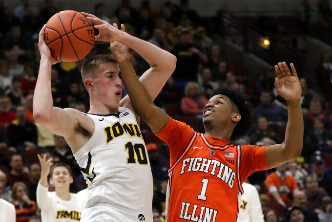 Iowa's Joe Wieskamp (10) looks to pass against Illinois's Trent Frazier (1) during the second half of an NCAA college basketball game in the second round of the Big Ten Conference tournament, Thursday, March 14, 2019, in Chicago. (AP Photo/Nam Y. Huh)