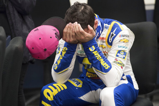 Chase Elliott (9) gathers himself while in the media room after winning a NASCAR Cup Series auto race at the Martinsville Speedway in Martinsville, Va., Sunday, Nov.1, 2020. (AP Photo/Lee Luther Jr.)