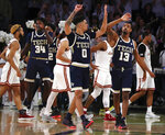 Georgia Tech guards Michael Devoe (0) and Curtis Haywood II (13) high-five as time expires to beat Boston College 81-78 in overtime in an NCAA college basketball game, Sunday, March 3, 2019, in Atlanta. (Curtis Compton/Atlanta Journal-Constitution via AP)